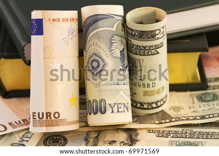 Multiple global currencies and books connect knowledge and data-driven, strategic global currency analysis to 21st century business