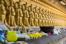 Multiple golden colour statues of lord Buddha at Kelaniya temple.