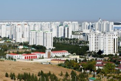 Multiple luxury residential buildings built with white marble in Ashgabat, the capital of Turkmenistan in Central Asia. City recordist of the highest concentration of white marble edifices.