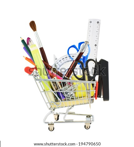 Multiple office tools in a shopping cart, isolated over the white background