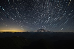 Multiple Photos Stacked To Make Star Trails Above Mt Rainier In Washington State
