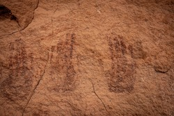 Multiple Pictograph Handprints On Sandstone Wall in canyonlands National Park