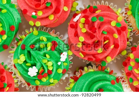 Multiple Red and Green Cupcakes with Sprinkles
