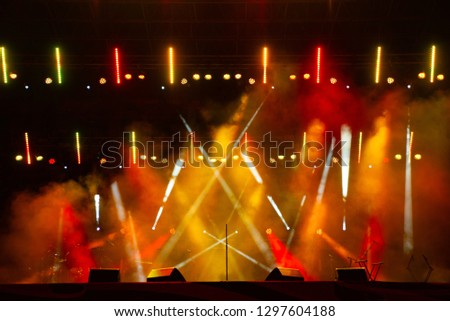 multiple spotlights on a theatre stage lighting rig #1297604188