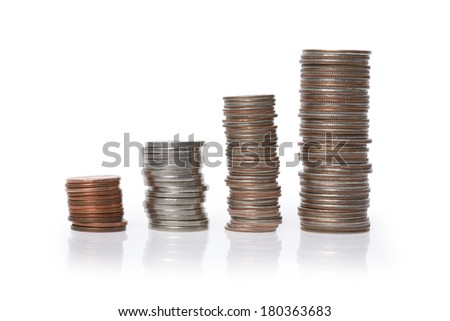 Multiple stacks of American coins on white background