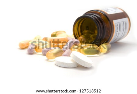 Multiple tablets and a bottle