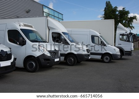 Multiple trucks park in a large parking lot #665714056