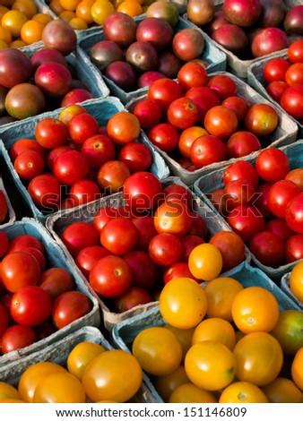 Multiple variety of cherry tomatoes at local food market. - stock photo