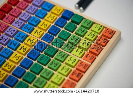 Multiplication table . Macro mode. Colored wooden cubes.Teaching children math and numeracy. Mental math.