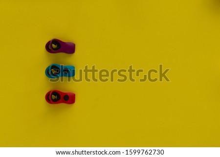 Multipurpose hooks Hooks on yellow background.