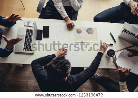 Multiracial business people managers, on a meeting, discuss and argue, listen and thinking, creating new ideas and marketing strategies.
