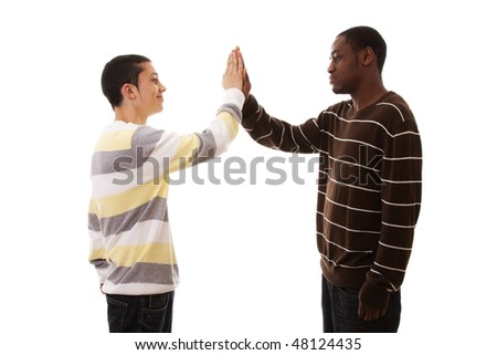 multiracial friends hand to hand (isolated on white)