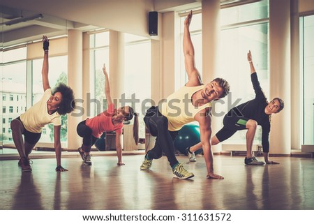 Multiracial group during aerobics class