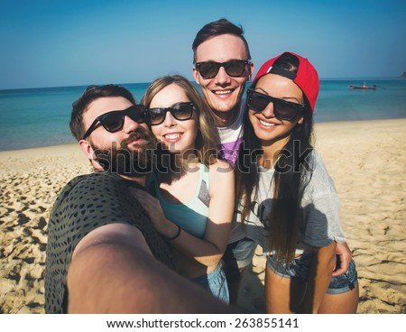 Multiracial group of young hipster friends make selfie photo with smartphone camera while traveling across Asia on vacation