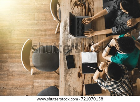 Multiracial group of young students studying, Teenage sitting together at table with books and laptop for researching information for their project. co-working space, top view ストックフォト ©