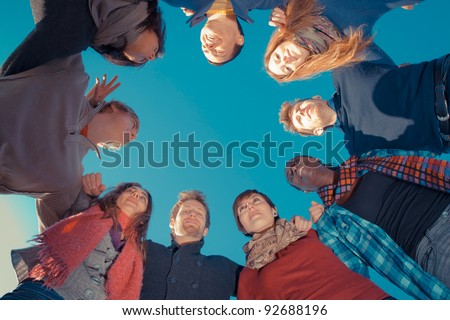 Multiracial People Holding Hands in a Circle, Low Angle View