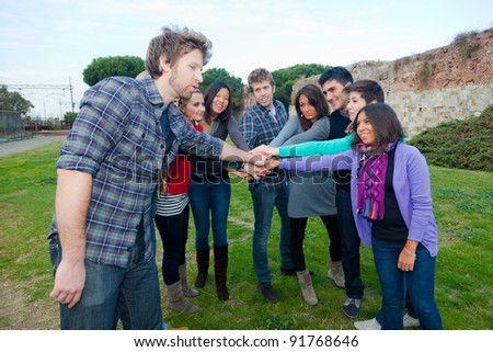 Multiracial Students with Hands on Stack