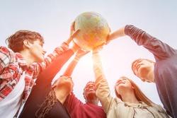 Multiracial Teen Couple Holding Globe Map - stock