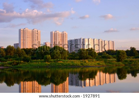 multistoried dwelling building on a background sky during sunset - stock photo