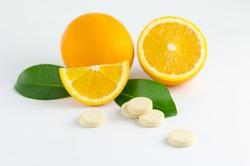 Multivitamin effervescent tablet pills. Vitamin C soluble pills. Fizzy Vitamin C for Drink