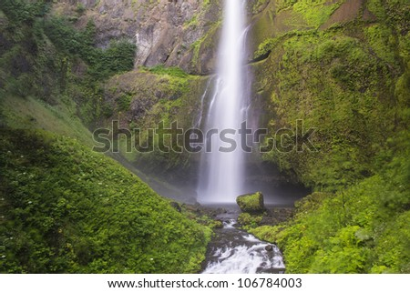 Multnomah Falls, Columbia River Gorge, water blurred in motion - stock photo