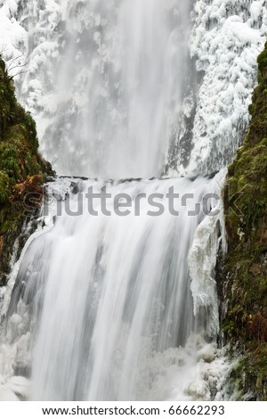 Multnomah Waterfalls frozen in winter. Columbia River Gorge National Scenic Area, Oregon.