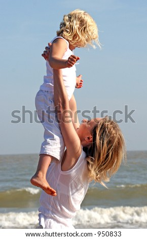 Mum and a baby on the beach