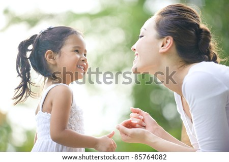 Mum and daughter spending time together in the park