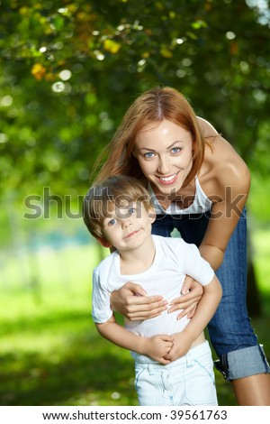 Mum and small son together in a summer garden