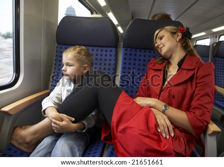 Mum and the son travel in a train