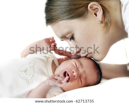 Mum kissing crying baby