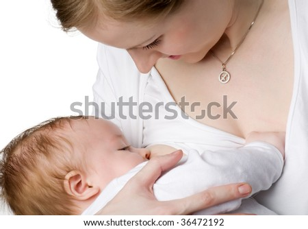 Mum looks at the kid sucking a breast, isolated on white - stock photo