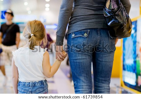 Mum with a daughter at the airport