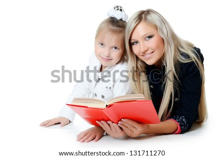 Mum with a daughter read the book