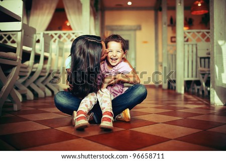 Mum with a daughter sit on a floor!