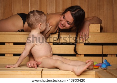 Mum with the small son are heated in a sauna