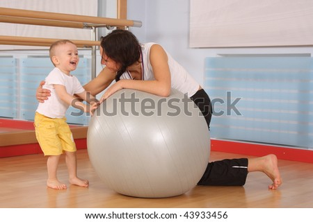 Mum with the son play a sports hall