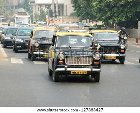 MUMBAI,INDIA - DECEMBER 7 :Mumbai traffic with several unidentified classical ambassador cabs,it's unique style of taxi service on December 7,2009 in Mumbai,India.Bombay is most populous city in India