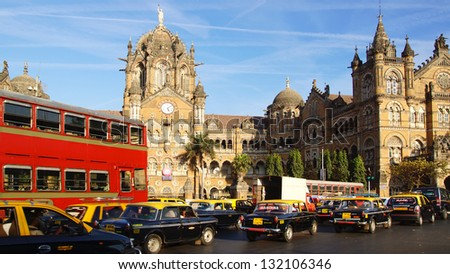 MUMBAI,INDIA - FEBRUARY13:Black-yellow cabs in front of the Victoria Terminus. Designed by Frederick William Stevens. Victoria Terminus, is a UNESCO World Heritage Site on Febuary 13, 2012 in Mumbai