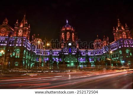 Mumbai, India - January 26, 2015 - Chhatrapati Shivaji Terminus (Victoria Terminus) illuminated with multi-colored lights in the evening for India Republic Day #252172504