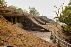 Mumbai, India: Kanheri Caves exterior which is a group of caves and rock-cut monuments cut into a massive basalt outcrop in the forests of the Sanjay Gandhi National Park