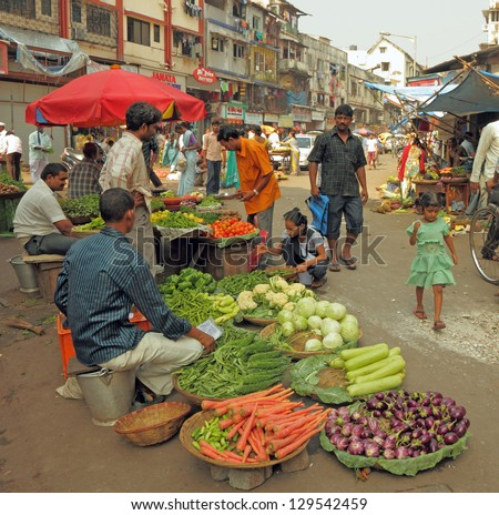 MUMBAI, INDIA -NOV 27: Street vendors sell vegetables  on Nov. 27, 2010 in Mumbai, India. Agricultural sector makes up 18.1% of GDP. India is the biggest producer of fruits and second for vegetables.