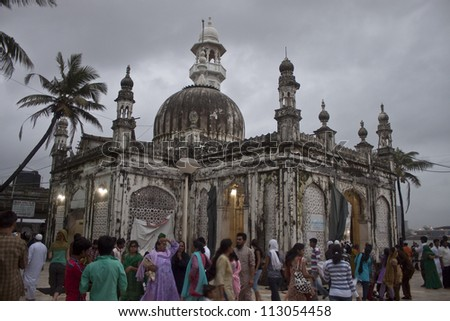 MUMBAI INDIA SEPTEMBER 6 Devottes at Haji Ali Mosque on September 6 2011 in Mumbai India Mosque was constructed in 1431 in memory of a rich Muslim merchant.