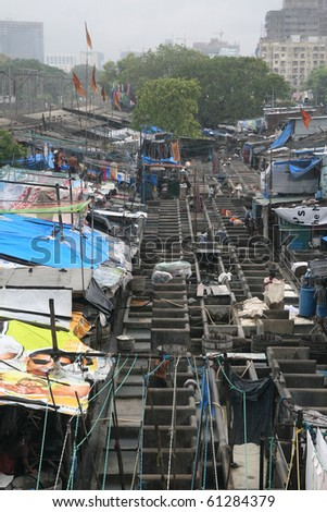 MUMBAI - JUNE 24: People at Dhobi Ghat, the world's largest outdoor laundry on June 24, 2010 in Mumbai, India.