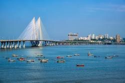 Mumbai skyline Bandra - Worli Sea Link bridge with fishing boats view from Bandra fort. Mumbai, Maharashtra, India