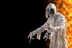 Mummy in an halloween night with flames on the right