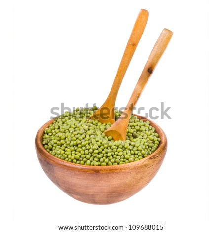 Mung bean in a wooden bowl with two spoons isolated on a white background.
