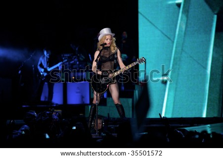MUNICH - AUGUST 18: Singer Madonna performs onstage at Olympic Stadium, 'Sticky & Sweet Tour' August 18, 2009 in Munich, Germany. - stock photo