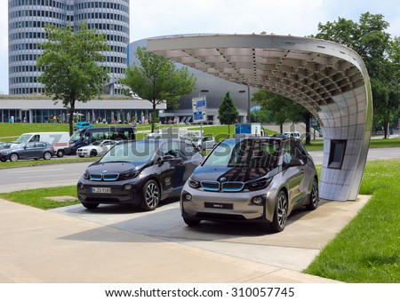 MUNICH, BAVARIA, GERMANY - JULY 1, 2015: electric cars (i3, i5, i8) BMW near BMW Museum and office bmw in Munich, Germany. Black, grey, gray and white car bacground