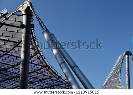 MUNICH, GER - OCTOBER 14, 2018: Olympic Stadium in the Olympic Park. Partial view of the famous rooftop, built for the Olympic Games 1972. No persons. Blue clear sky. Detail shot. #1213915015
